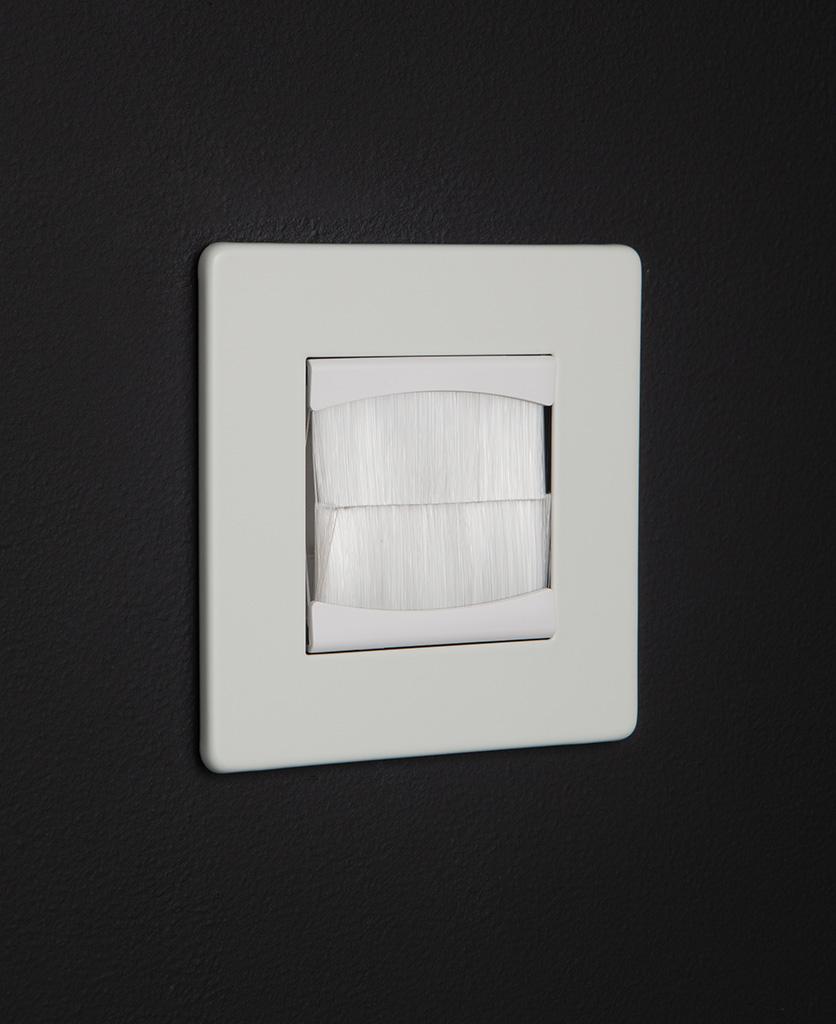 White single brush plate against black background