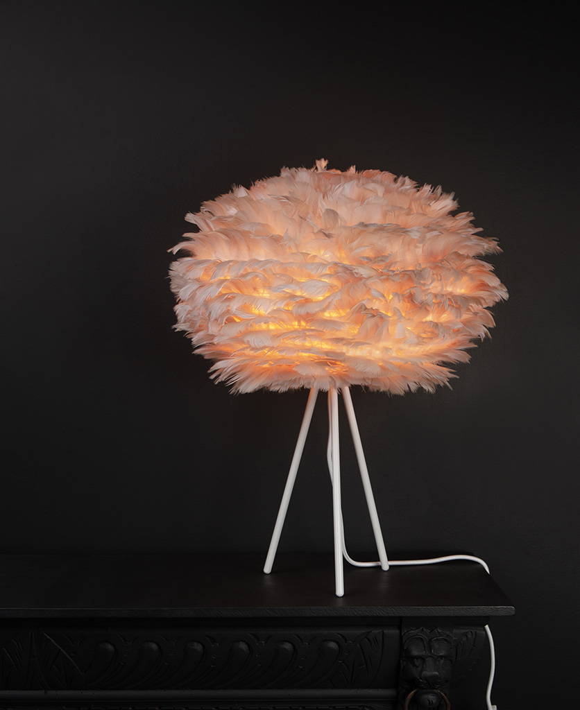 tripod table lamp shade with white tripod base and brown feather shade against black background