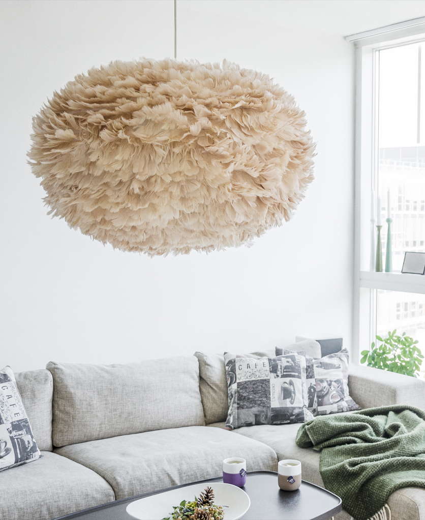 umage brown feather lamp ceiling pendant suspended above sofa against white wall
