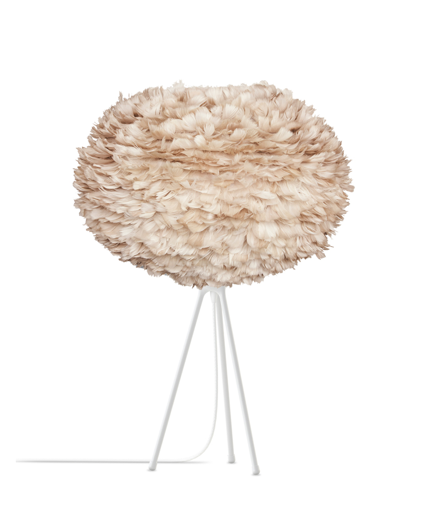 brown feather tripod table lamp with white base on a table against white background