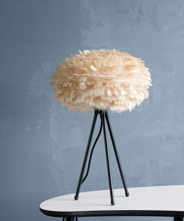 brown feather tripod table lamp on a table against grey background