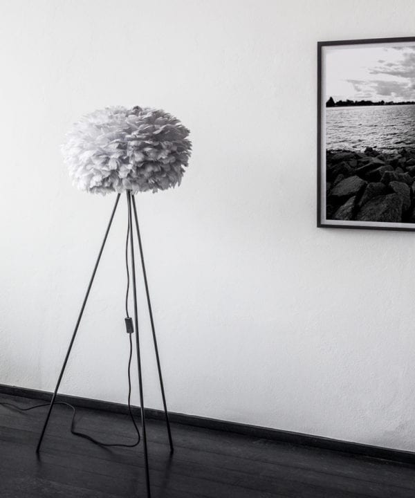 medium grey umage feather floor lamp with black stand against white background