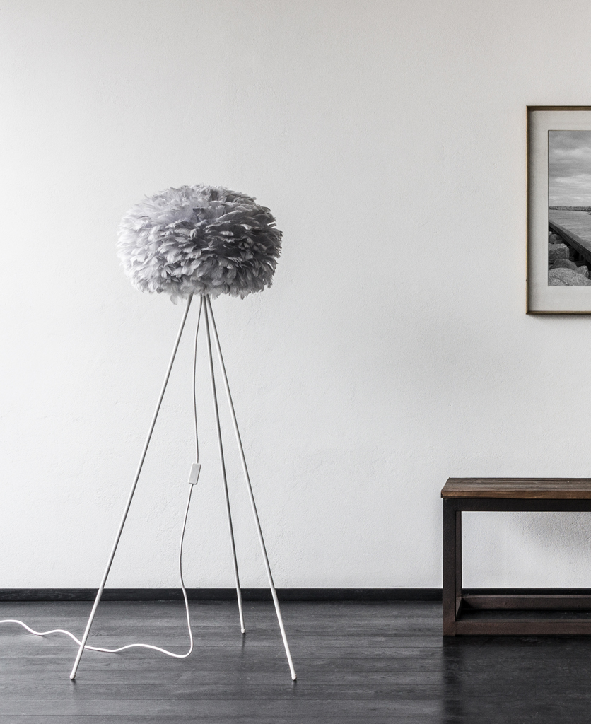 grey umage large feather floor lamp with white stand against white lifestyle background