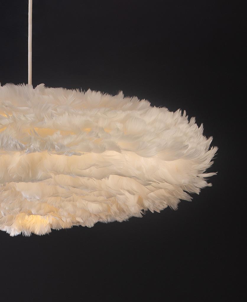 white esther umage feather pendant light on back blackground close up