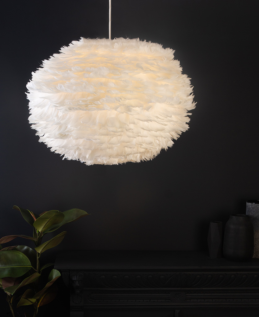 white umage feather pendant light with white cord set on black background close up lifestyle