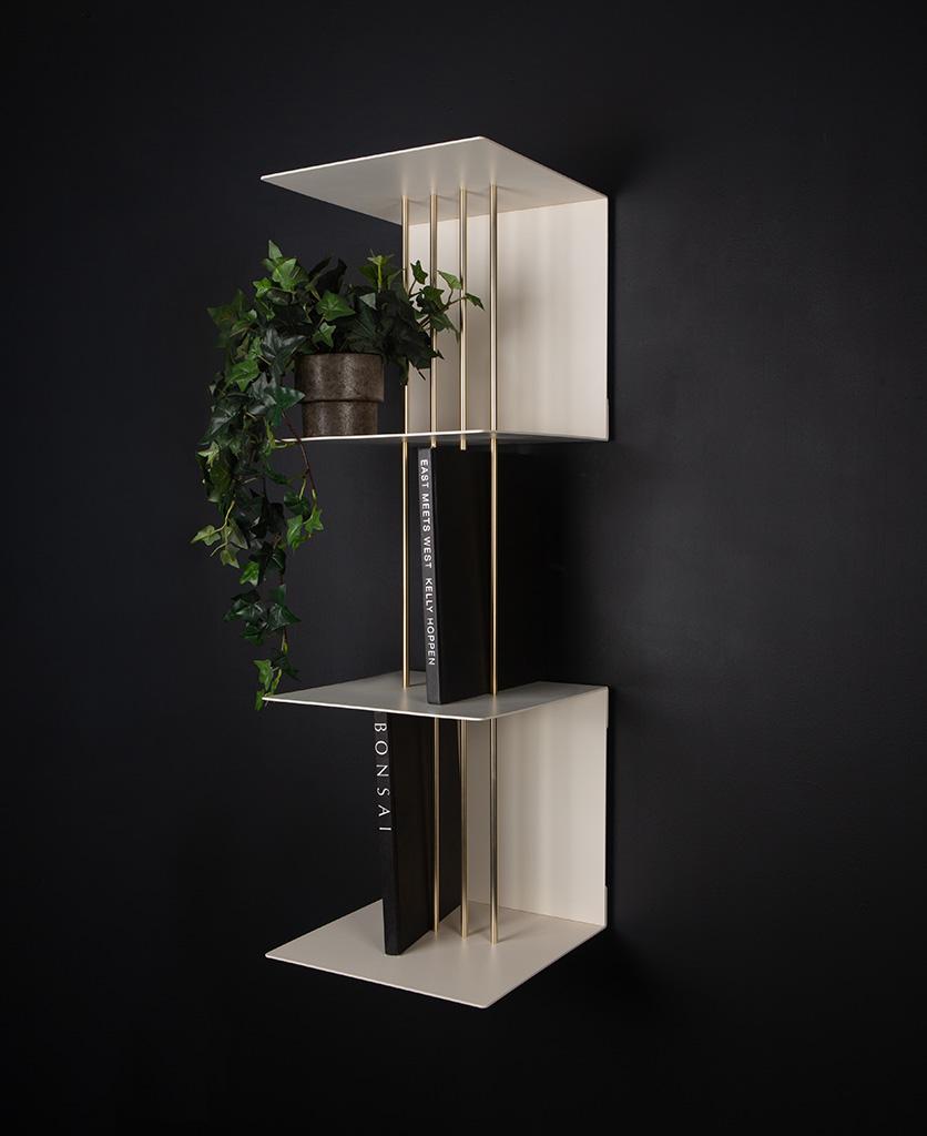 double umage teaser shelf in pearl white against black background