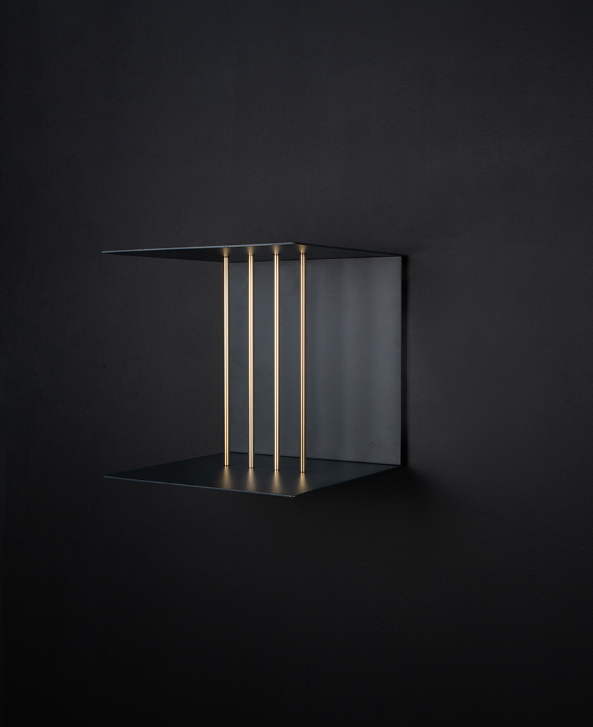 single umage anthractite teaser shelf on a black wall