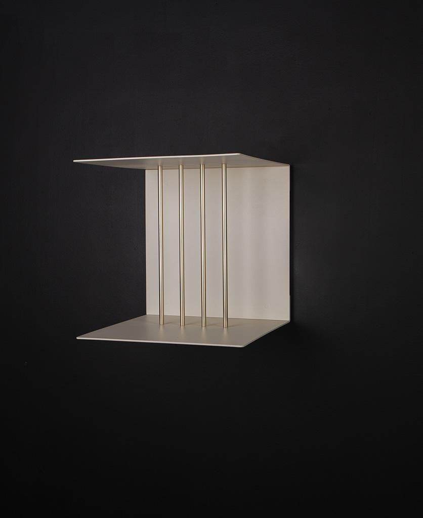 single umage pearl white teaser shelf against black background