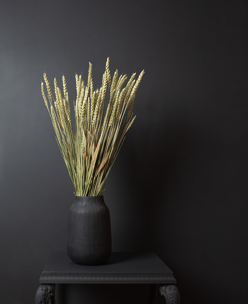dried wheat bouquet in black vase