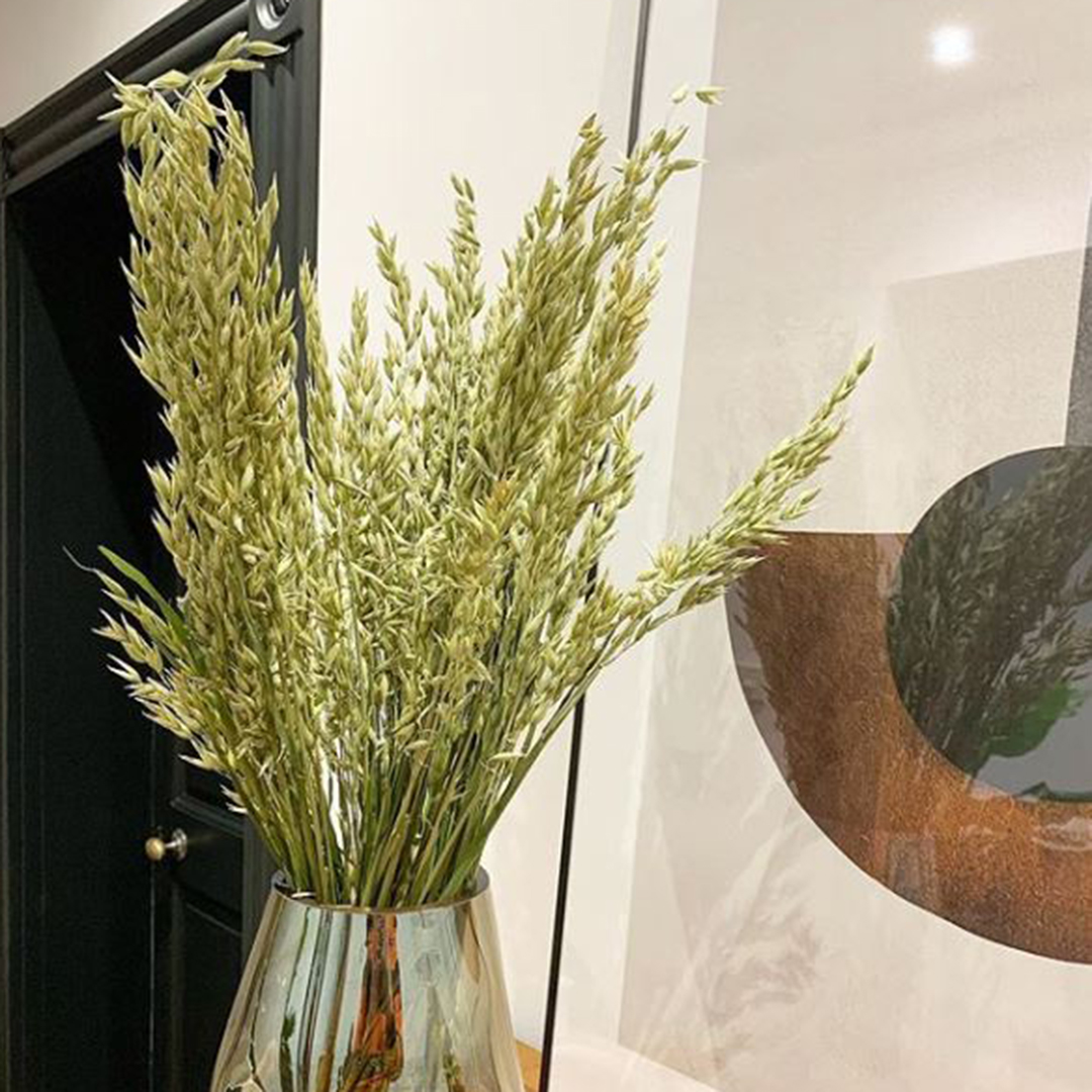 dried wheat bouquet in a glass vase in black and white interior