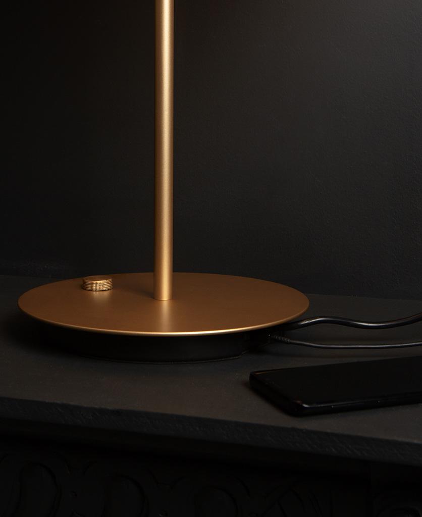 close up of base of umage asteria table light usb charging port against black background