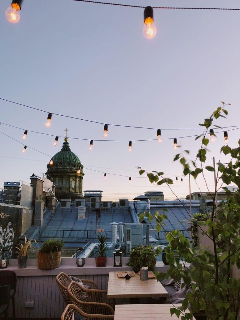 festoon lighting suspended over a balcony restaurant