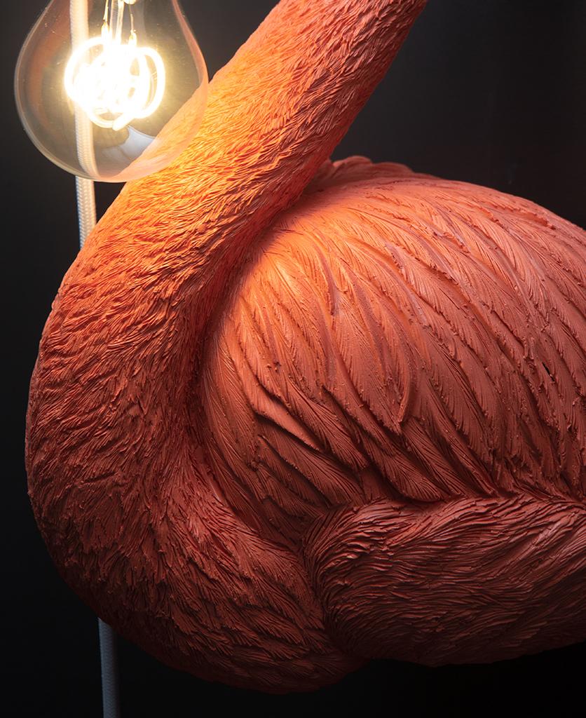 closeup of flamingo wall light feathers and bulb