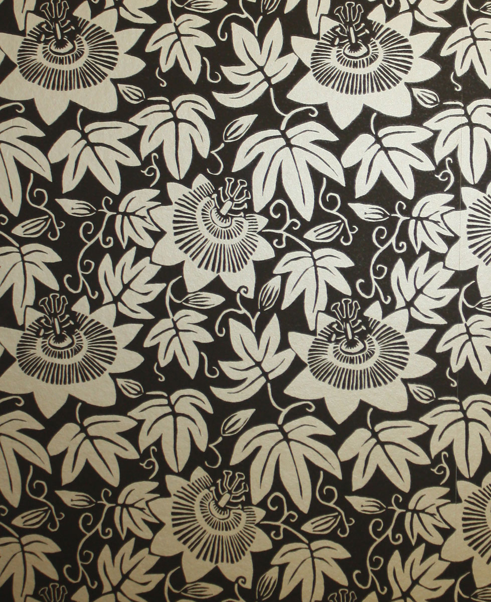 black wallpaper with gold floral pattern