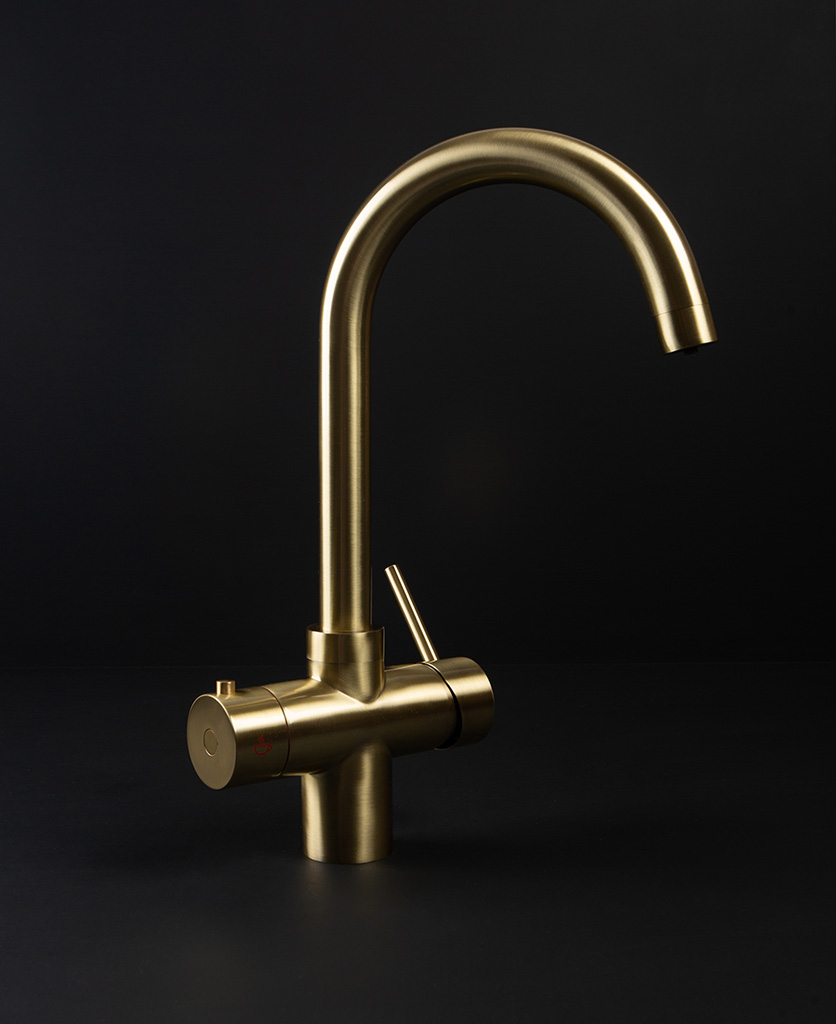 Monroe gold hot water tap on black background