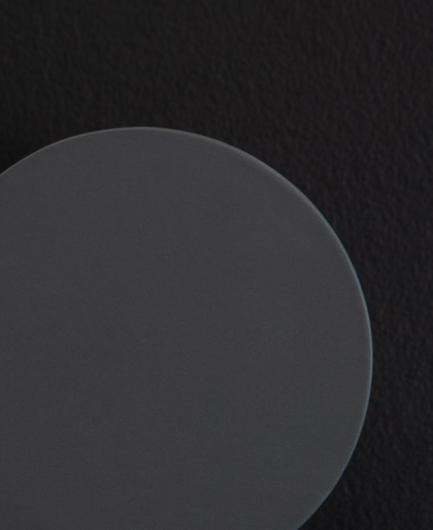 close up image of gunmetal blomus wall towel hooks on a black background