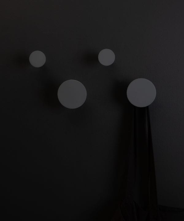 four gunmetal blomus wall towel hooks on a black background