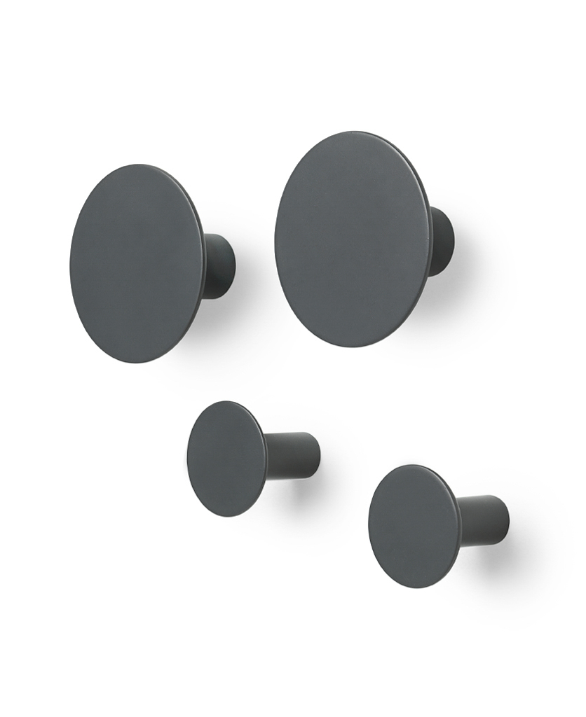 four gunmetal grey round blomus wall hooks on a white wall