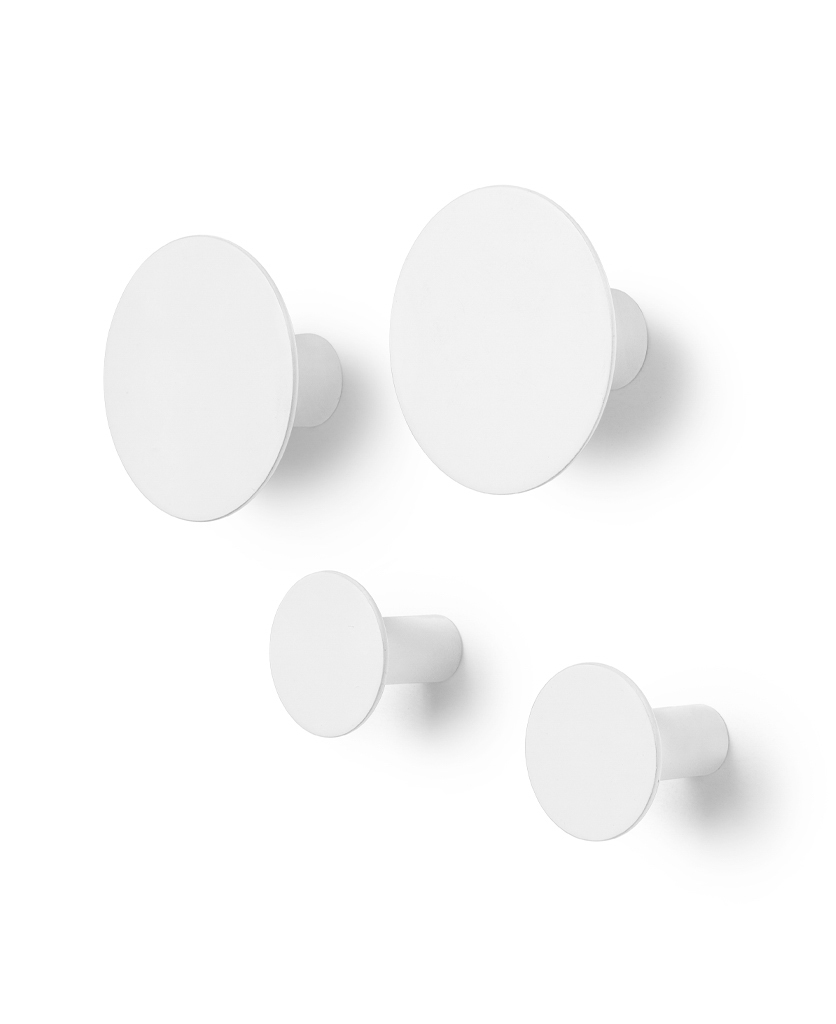 four lily white blomus wall hooks against a white background