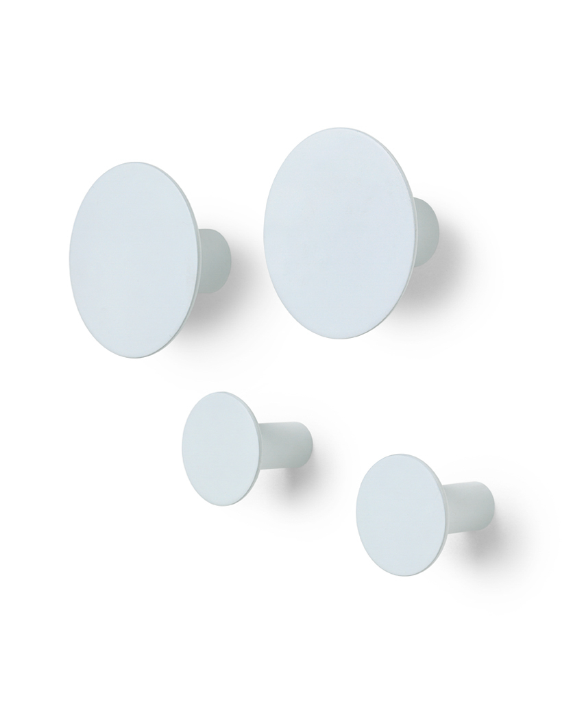 four pale blue circular hooks on a white back ground two large two small