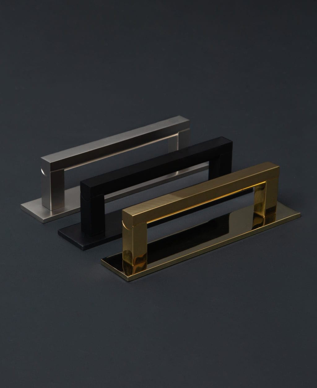 taipei metal handles with plate in black, silver & brass against black background