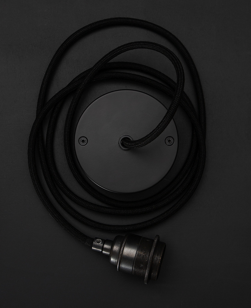 Black cord Set featuring black fabric cable, black bulb holder and black ceiling rose against black background