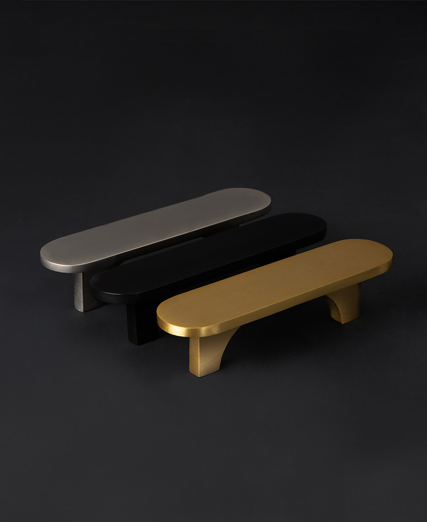 gold, silver and and black chrysler lozenge shaped kitchen cupboard handles