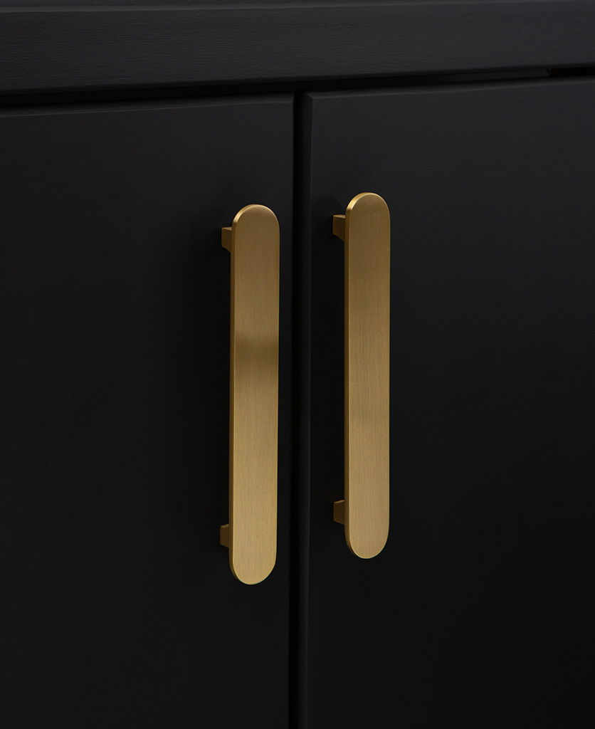chysler lozenge shaped metal kitchen cabinet handles in gold on black cupboard