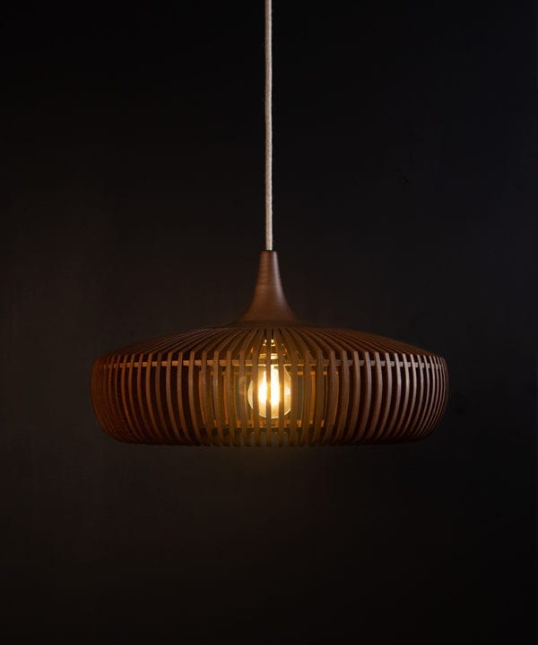wooden light shade with linen cable against black background