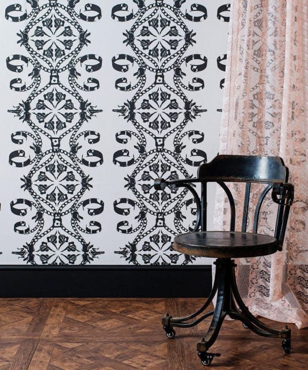 Maitrise White Wallpaper With Black Illustrations Set With Wooden Floors and Chair