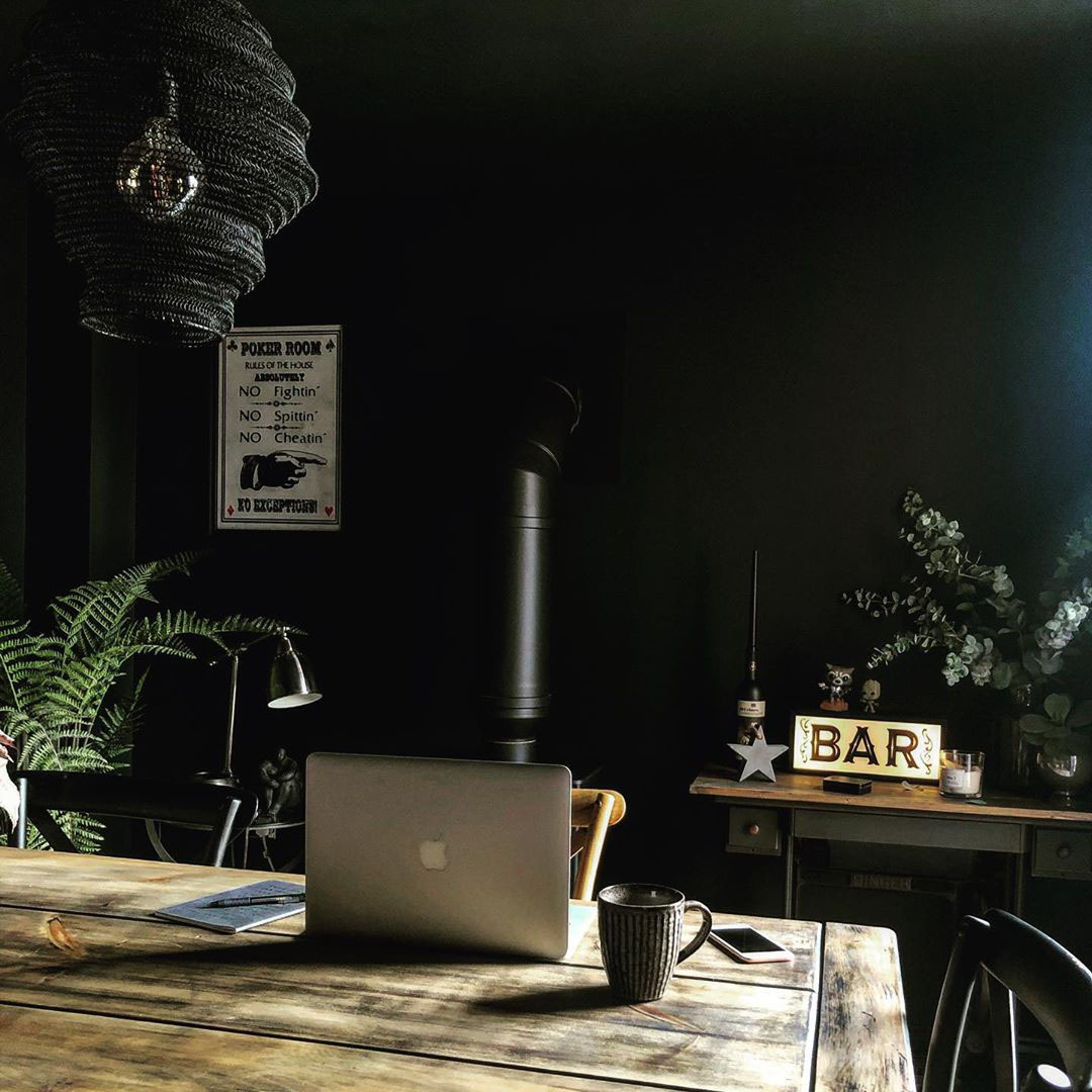 baya nest light in black above an office desk to spruce up the interior