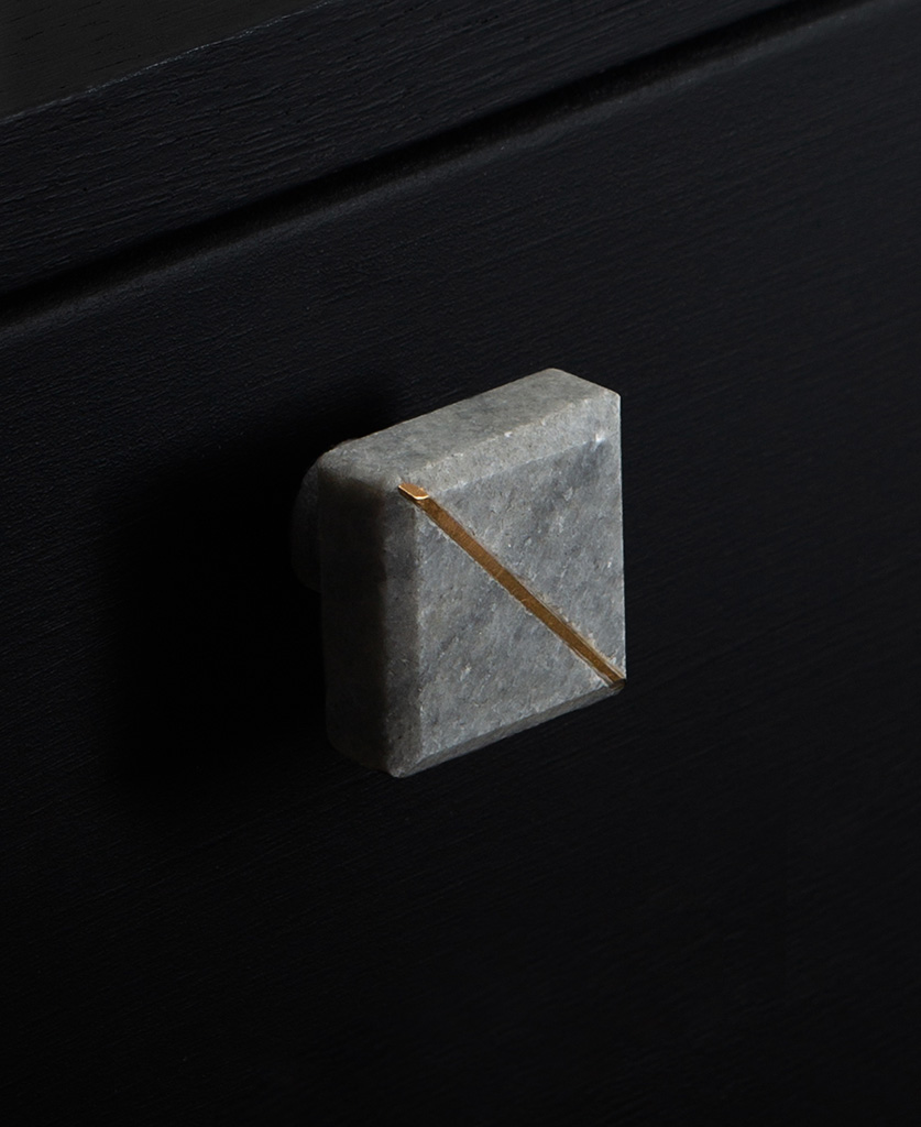 grey marble square knob with gold stripe on black drawer