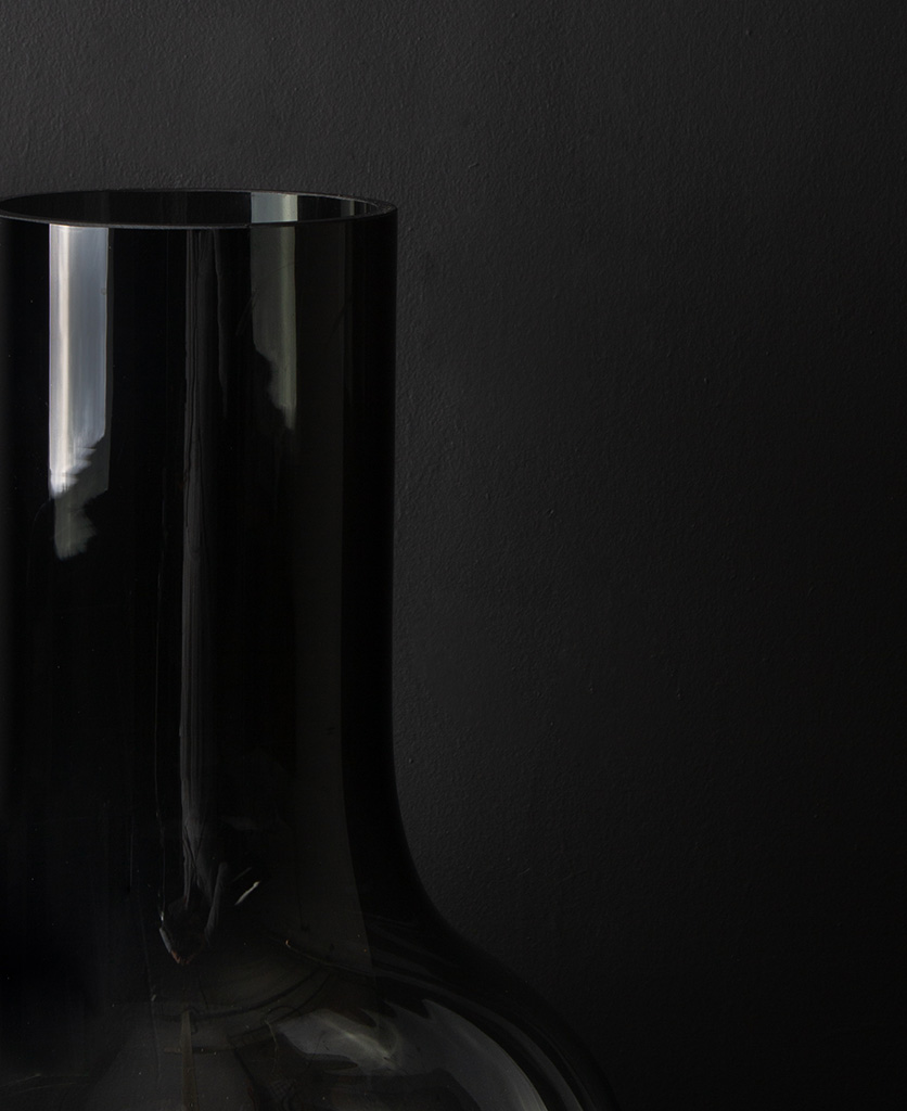 close up of bowl vase against black background