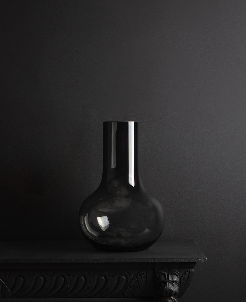 black bowl vase against black background