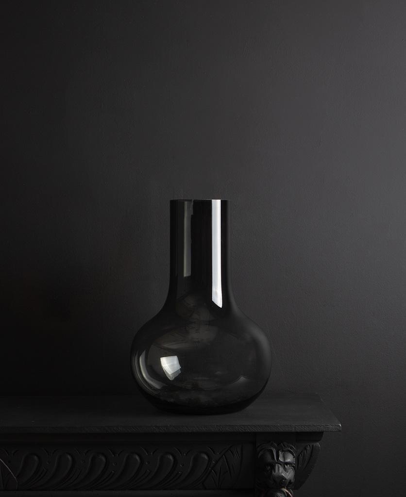 black glass bowl vase against black background