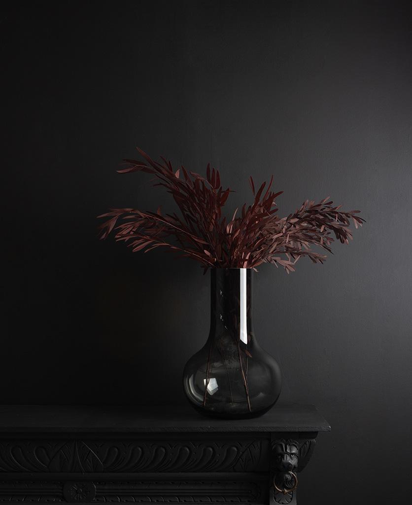 bowl vase vase with preserved red nicholii bouquet against black background