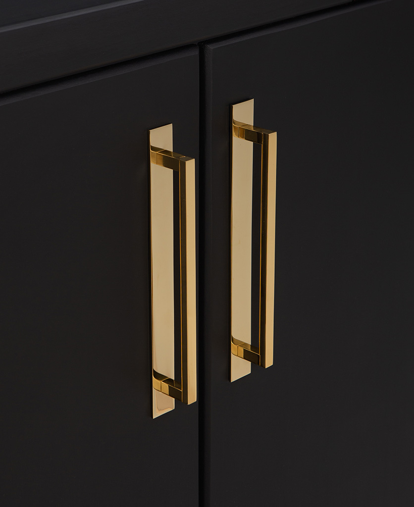 gold metal 24.2cms kitchen door handles on black cupboard