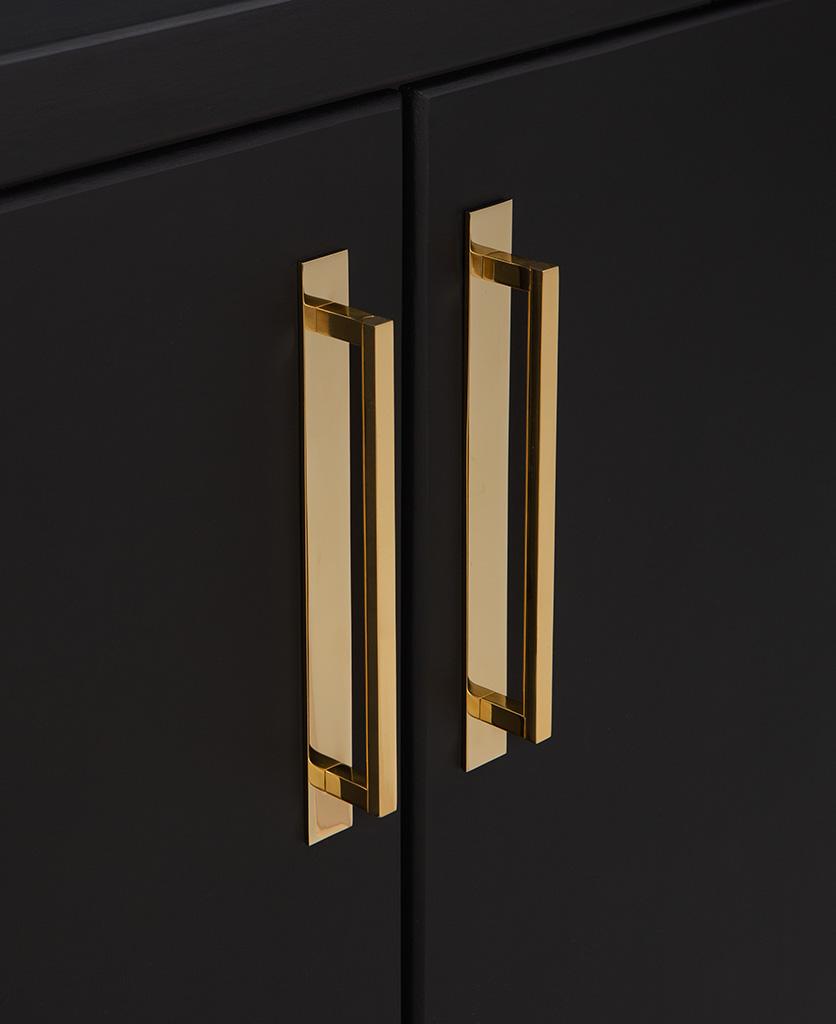 gold metal 24.2cms kitchen door handles on black cupboard
