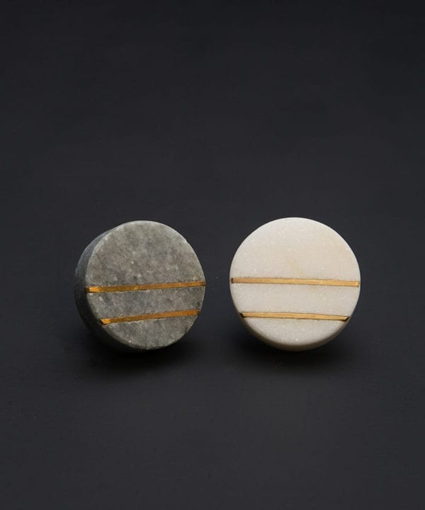 grey and gold knob and white and gold marble knobs on black background