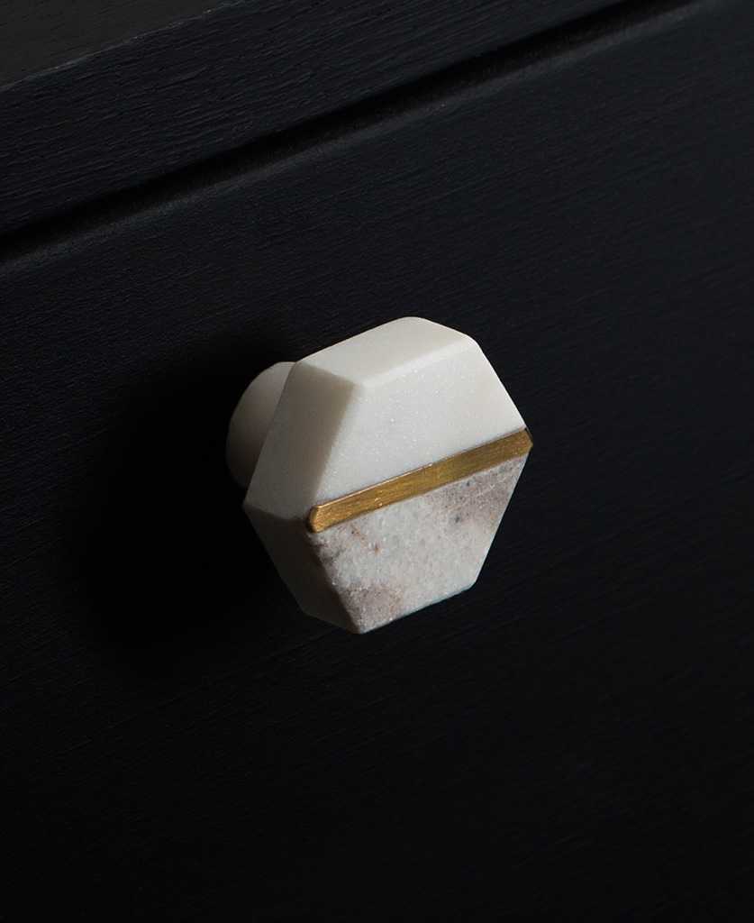 white and grey marble hexagonal knob on black drawer