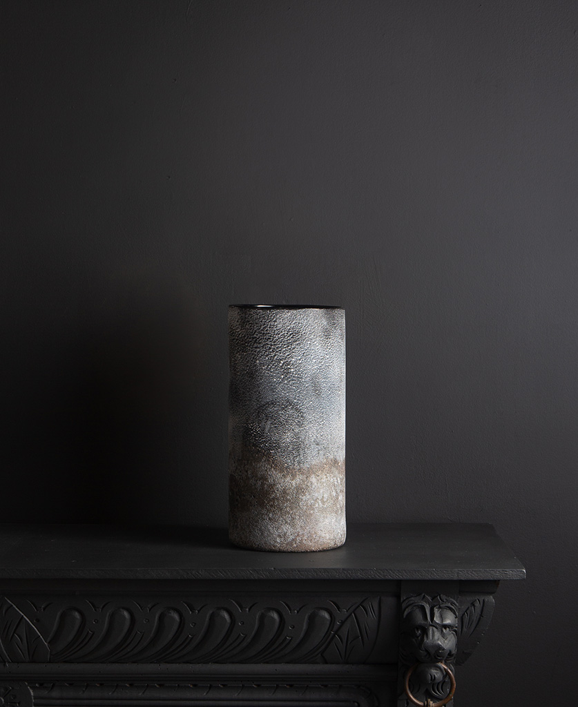 rock effect vase lifestyle shot against black background