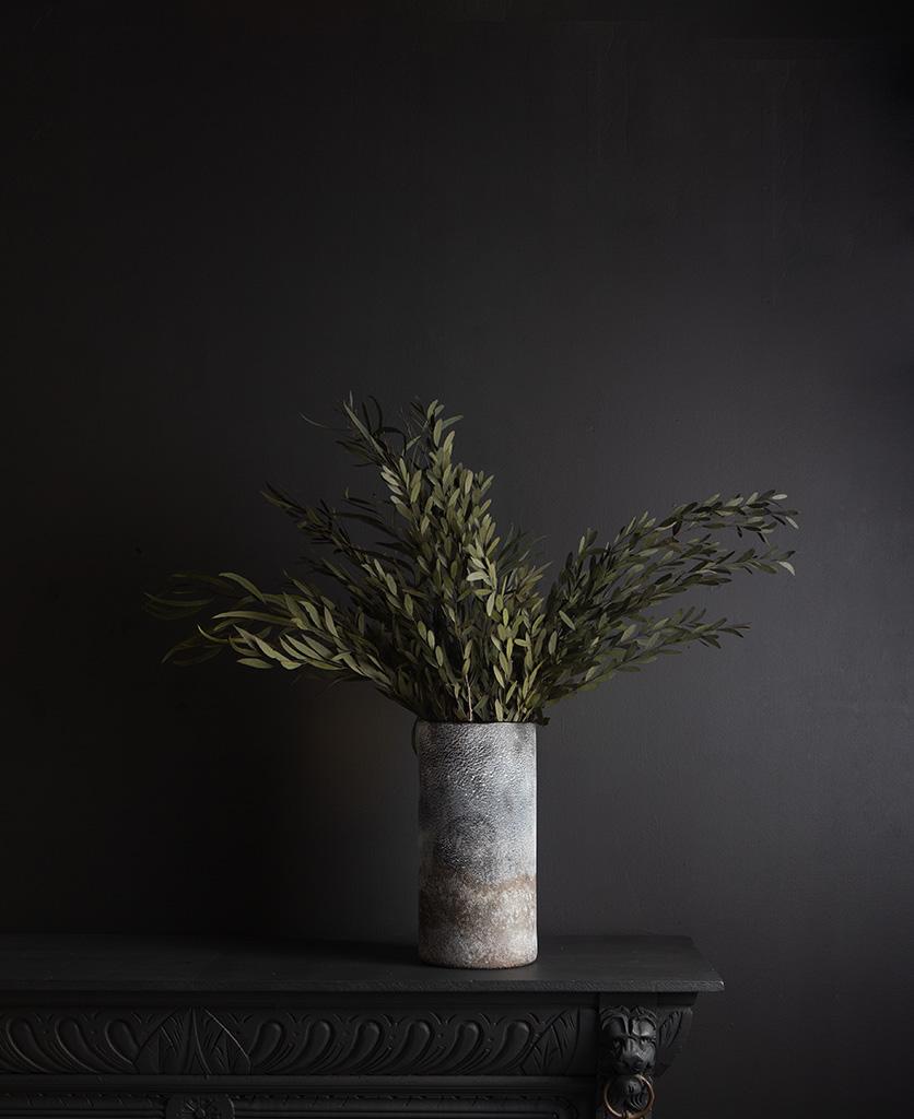 rock effect vase with preserved green nicholii against black background