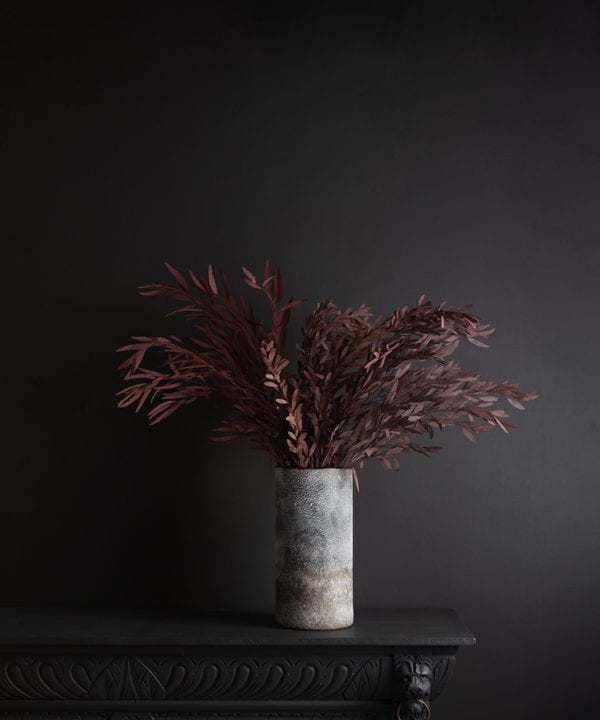rock effect vase with preserved red nicholii against black background
