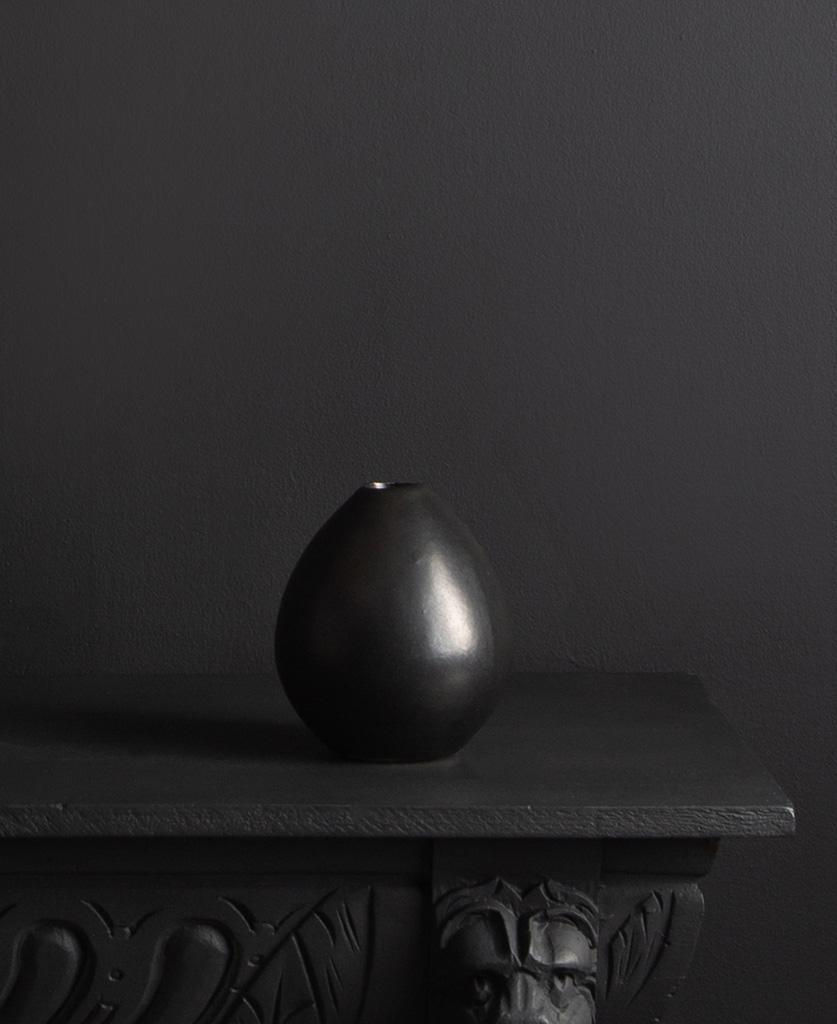 black stem vase against black background