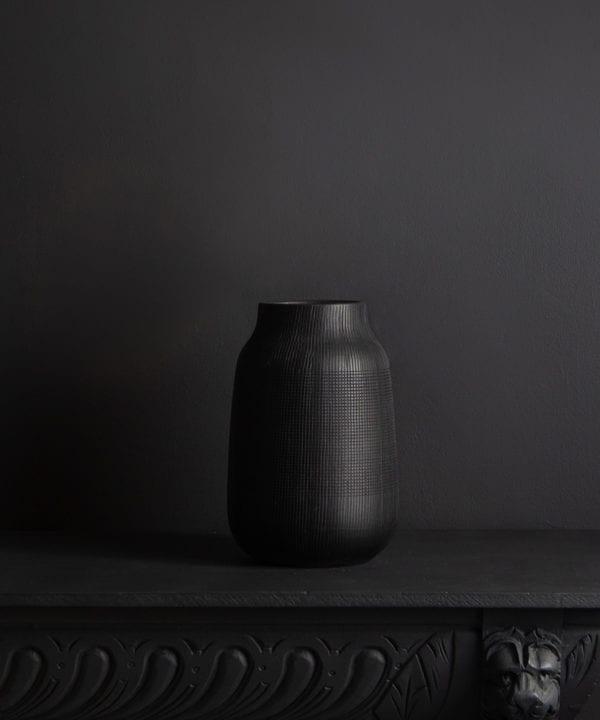 black vase against black background