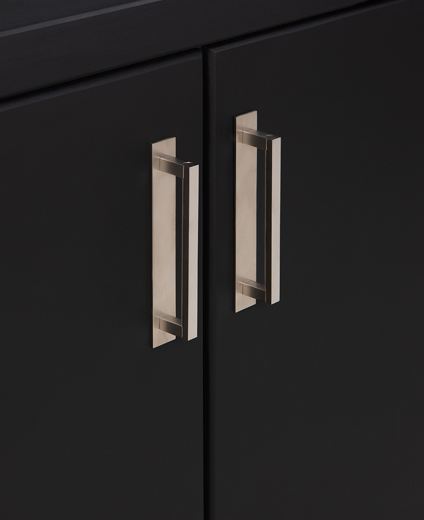 16.5cms silver metal handles with backplate on black cupboard