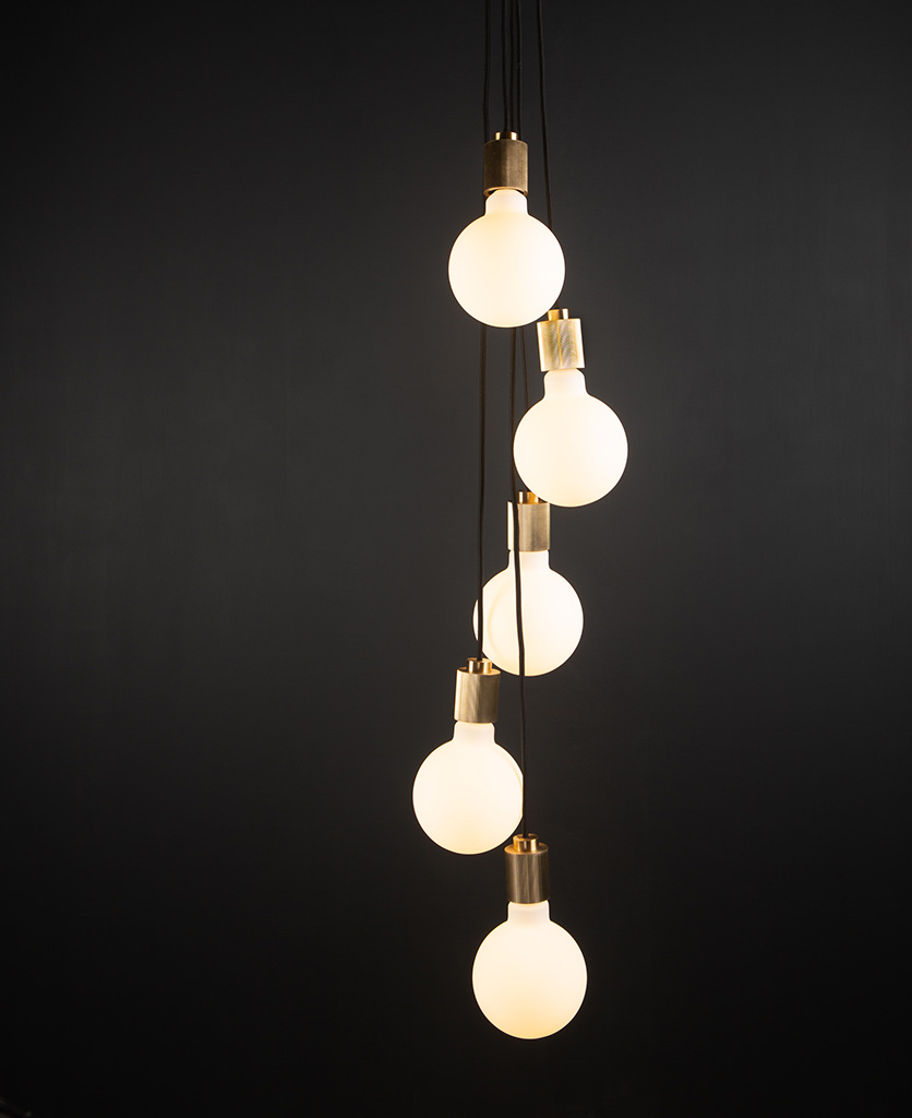 gold spiral pendant light fitting with five bulbs on black background