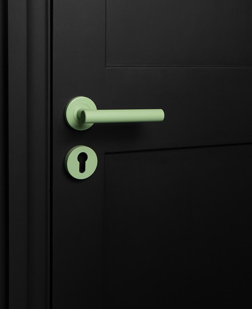 neo mint internal door handle with escutcheon plate on black door