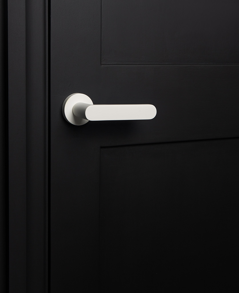 bourdelle white internal door handle on black door