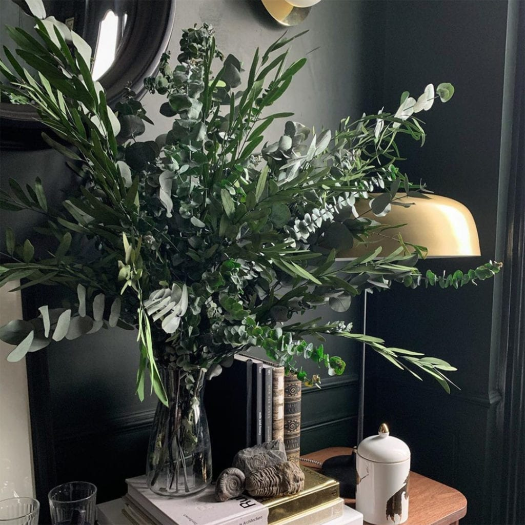 mixed preserved foliage bouquet in a black hallway